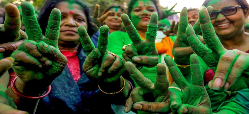 Trinamool Congress activists flash the victory sign after their candidate Prasun Banerjee won from Howrah Constituency seat (Image credit: PTI)