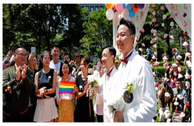 Hundreds of couples tie the knot on the first day of legal same-sex marriage in Taiwan