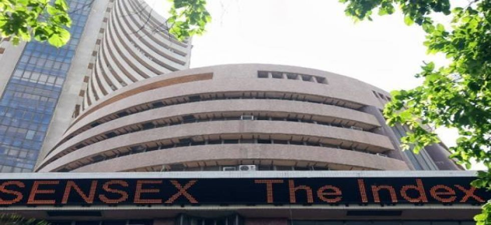 Sensex ends marginally lower at 39,741 points, Nifty settles inches up by 8 points