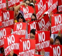 Hong Kong government suspends controversial extradition bill after mass protests