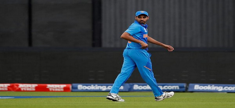 Bhuvneshwar Kumar will definitely miss the game against Afghanistan but he faces a race against time for the West Indies and England game. (Image credit: ANI Twitter)