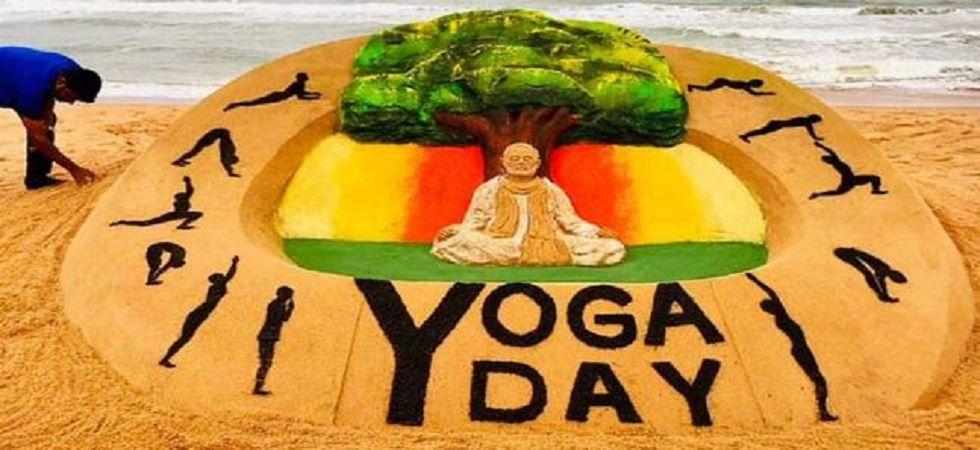 A sand art on International Yoga Day by sand artist Sudarsan Pattnaik.