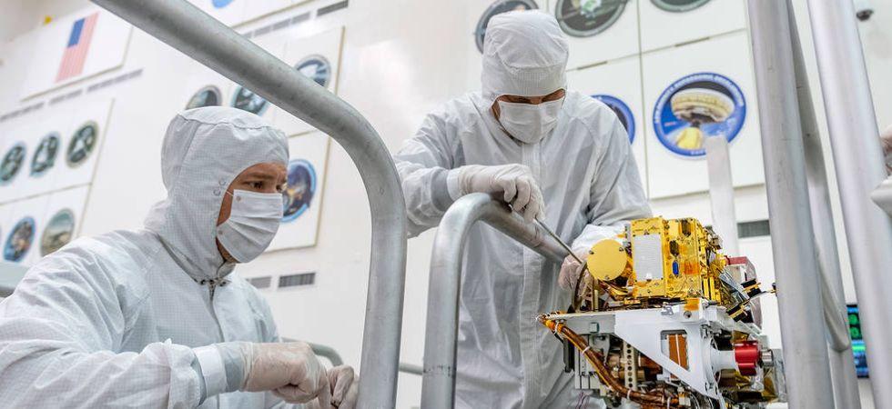 NASA engineers assembling Mars 2020 Rover (Photo Credit: NASA)