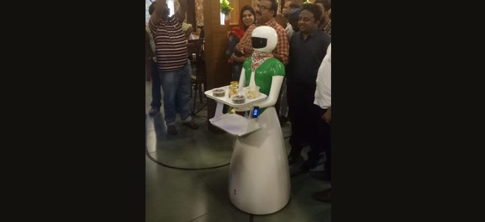 This Kerala restaurant has robot waiters to serve customers.