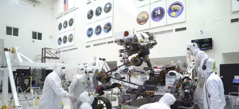 The rover has 7-foot-long robotic arm that can move a lot like yours.