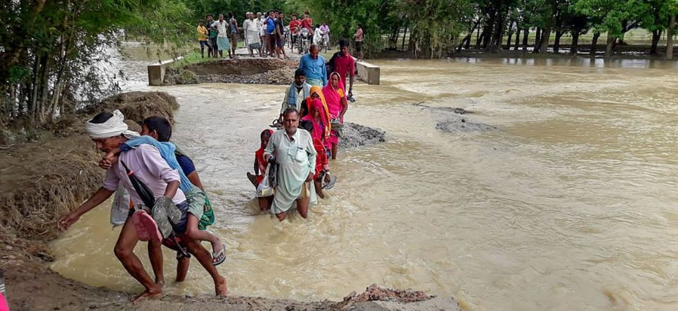 Food is being prepared for the affected population in Bihar at 442 community kitchens and distributed by 876 personnel equipped with 133 boats. (PTI Photo)