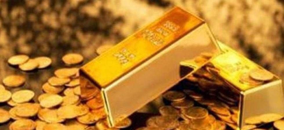 Gold falls Rs 100 on muted demand; silver firms up