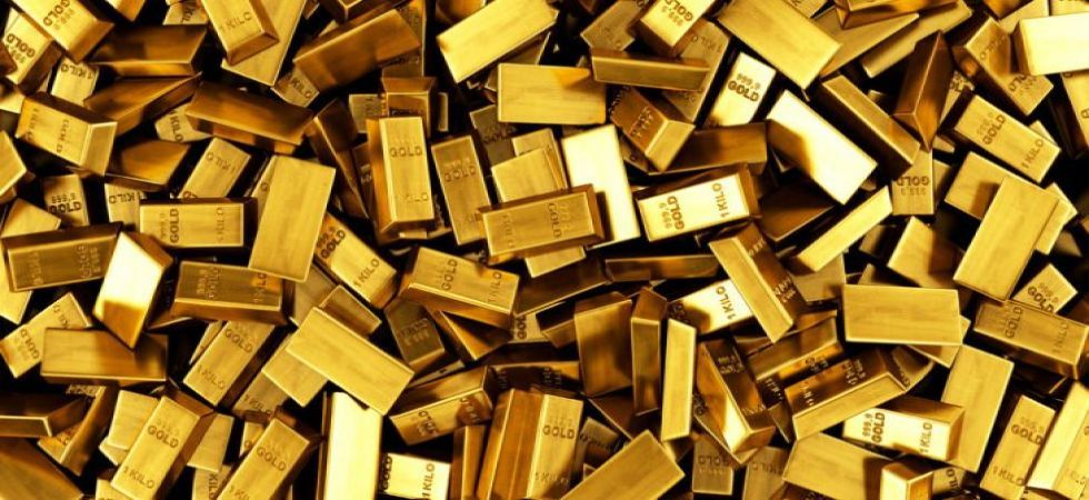 Gold slips from all-time high level, falls Rs 163