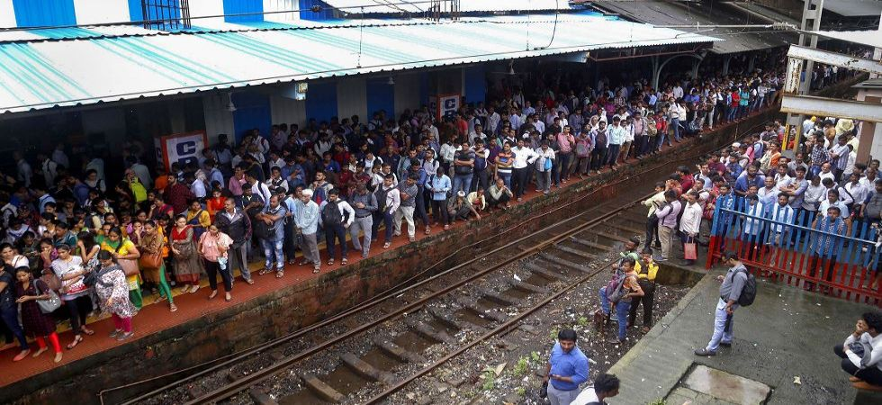 Passengers stranded at Thane railway station after heavy monsoon rains hit the local train services (Photo Source: PTI)