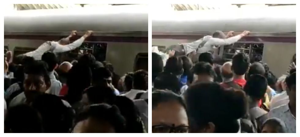 Man gets swept away by crowd at station (Photo: Twitter)
