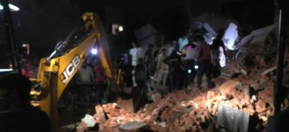 The building was located in Pragati Nagar area of the town in Kheda district. (Image Credit: ANI)