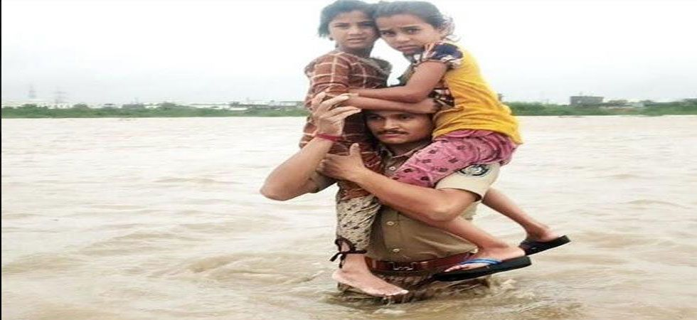 The constable, identified as Pruthvirajsinh Jadeja, walked through the flooded region despite the strong current. (Image Credit: Twitter)