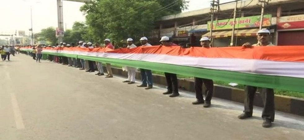 Locals form 15 Km long human chain in Chhattisgarh to unfurl Tricolor. (Image Credit: ANI)