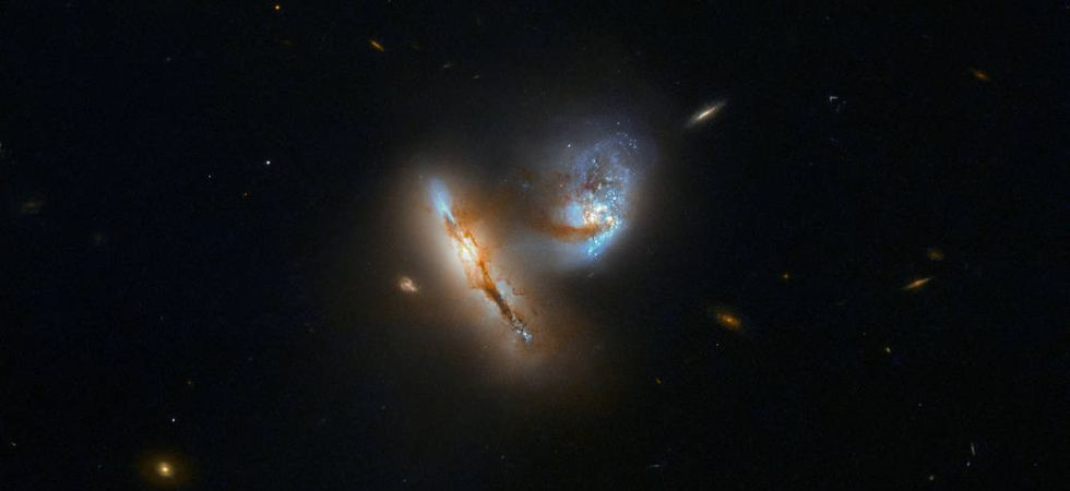 According to the European Space Agency (ESA), all that currently connects the two galaxies is a tenuous bridge of gas, dust and stars. (Photo: NASA)