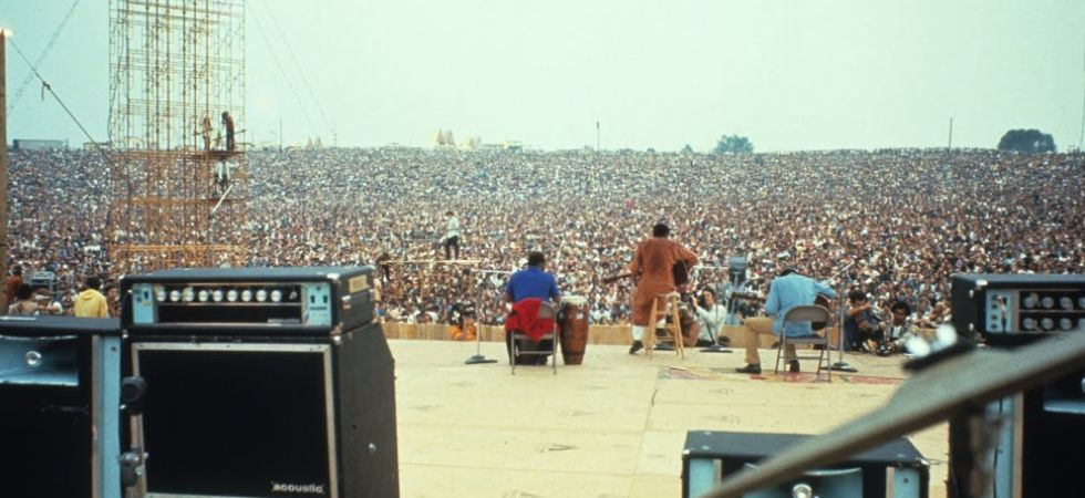 Richie Havens performing at the music fest. (Photo Credit: Woodstock)