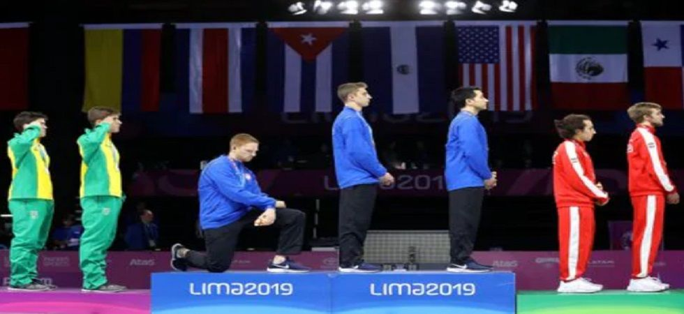 Race Imboden took a knee during the playing of the US national anthem while Gwen Berry raised a clenched fist before later calling out social injustice