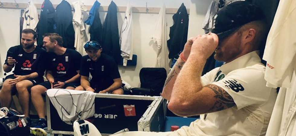 England bowler Stuart Broad twitter this picture of Ben Stokes hiding his face behind his cap.