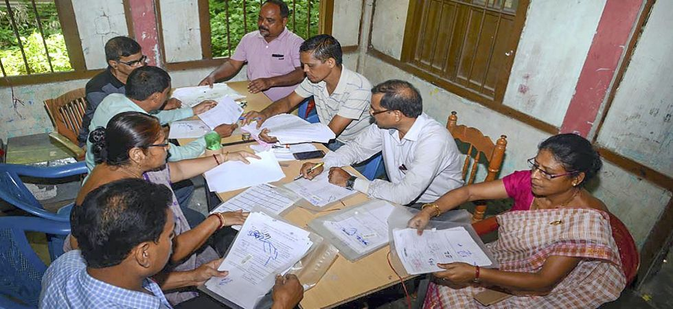 Officials check the documents submitted by people, ahead of the release of the final NRC list (Photo Source: PTI)
