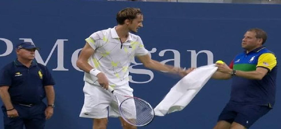 Daniil Medvedev received a code violation for angrily snatching the towel from a ballperson, threw his racquet and then covertly raised his middle finger next to his head as he began to walk. (Image credit: Twitter)