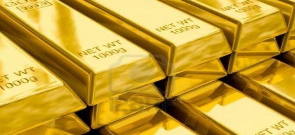 Gold prices dropped to a near one-month low on Tuesday in world markets
