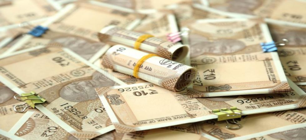The rupee opened on a cautious note and fell 13 paise to 71.84 against the US dollar in early trade on Wednesday