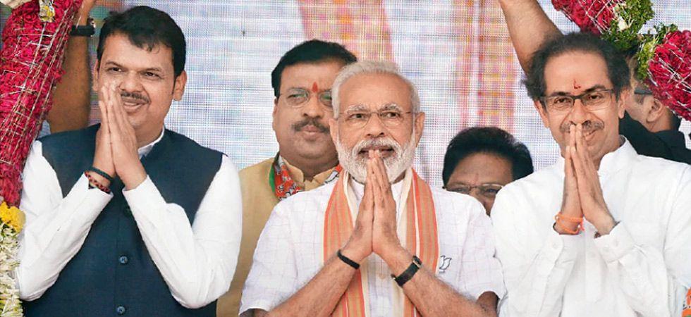 Prime Minister Narendra Modi with Shiv Sena chief Uddhav Thackeray and Maharashtra Chief Minister Devendra Fadnavis. (PTI file photo)