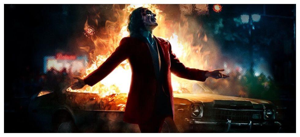 Joaquin Phoenix Laughs As The City Burns In New 'Joker' Poster (Photo: Twitter)