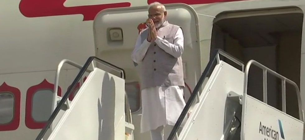 India's Ambassador to the US, Harsh Vardhan Shringla received prime minister at the airport. (Photo Credit: ANI)