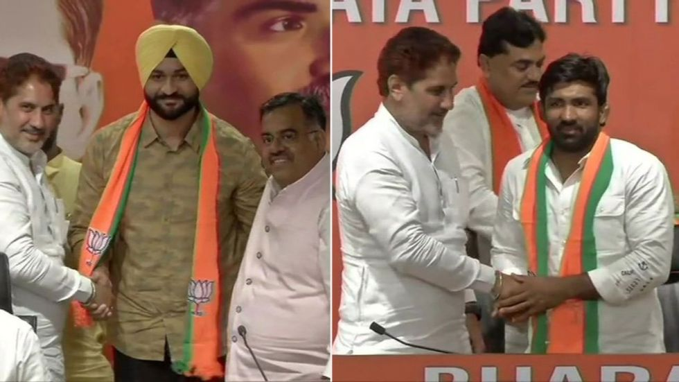 Wrestler Yogeshwar Dutt and former Indian Hockey captain Sandeep Singh joined BJP today in presence of Haryana party chief Subhash Barala. (Image Credit: ANI)