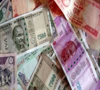 Which Currency Denomination Did Mahatma Gandhi First Appear On?