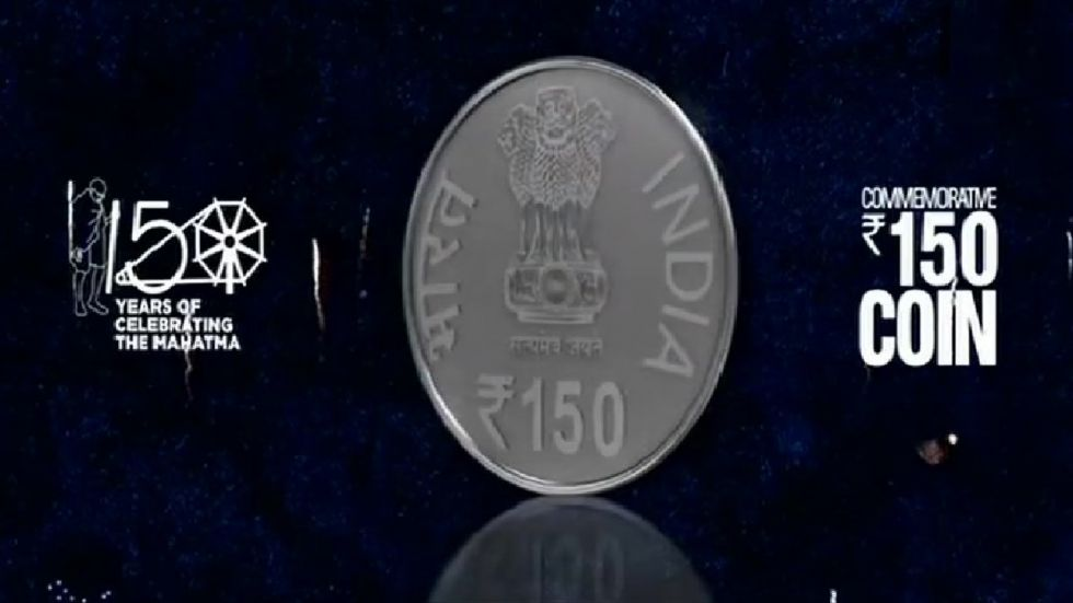 The Rs 150 coin released by PM Modi on the occasion of 150th birth anniversary of Mahatma Gandhi. (Photo: Twitter/@ANI)