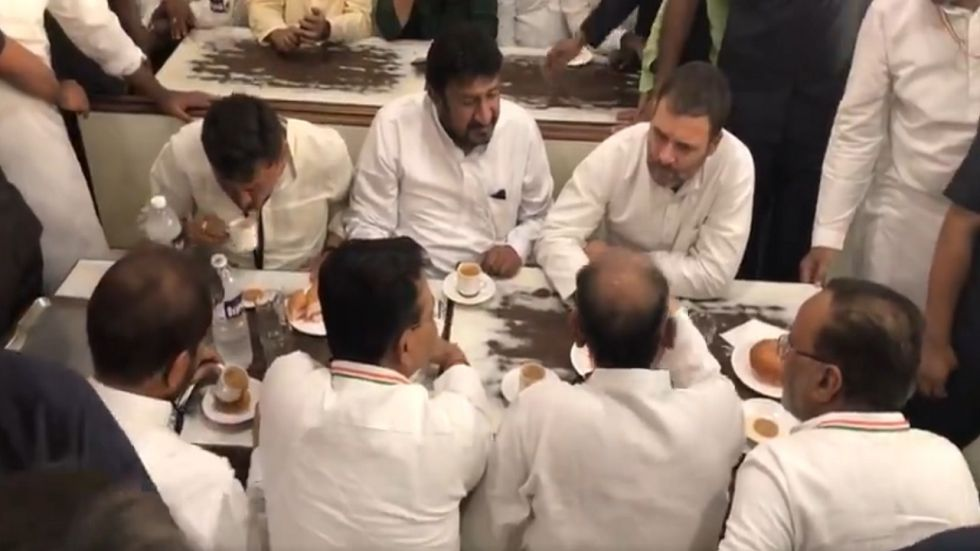 Rahul Gandhi eating with Congress workers during his Ahmedabad visit.