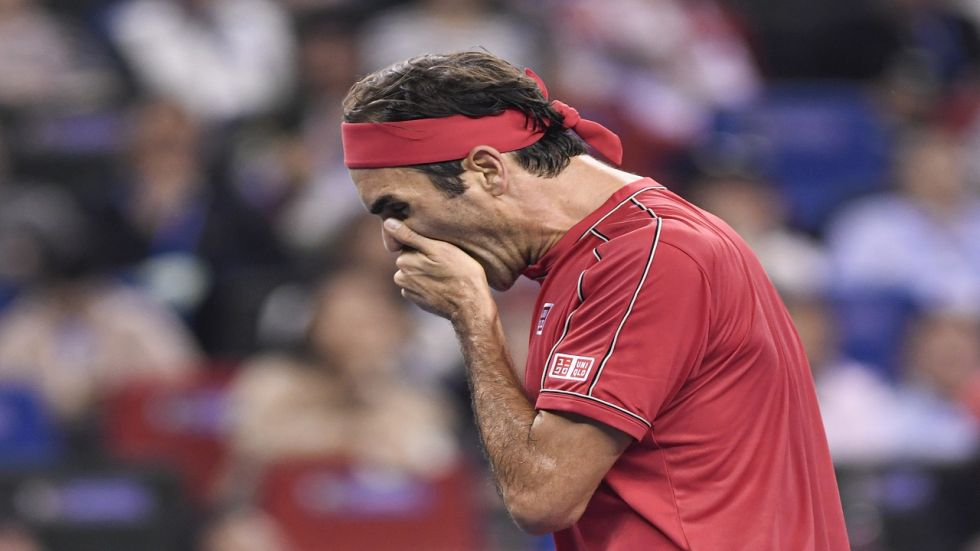 Roger Federer saved five match points to force a deciding set, but he then became engaged in a continual war of words with the chair umpire.