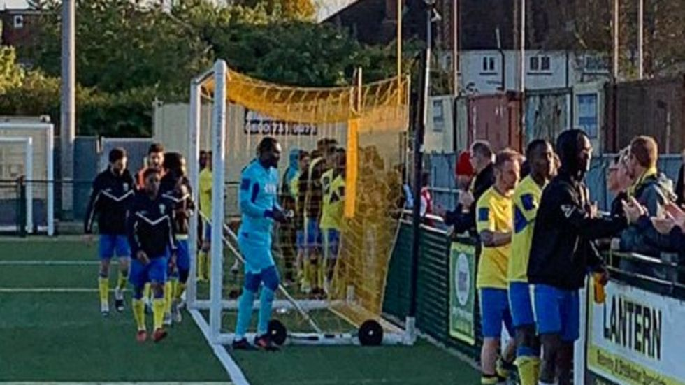 Haringey manager Tom Loizou said defender Coby Rowe suffered racial abus.e while Cameroonian goalkeeper Douglas Pajetat was also spat at, prompting him to take his players off the pitch