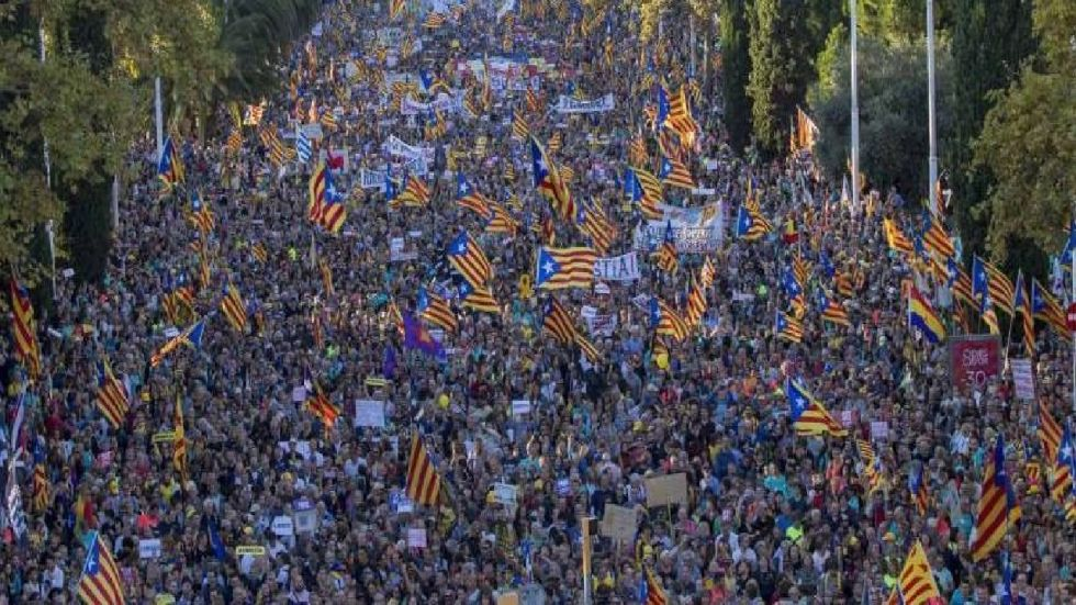 Police and violent protesters in Spain's restive Catalonia region clashed on Saturday after a massive rally in Barcelona.