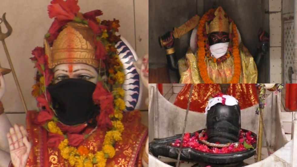 The idols were seen donning the masks at a temple in Sigra area in Varanasi town