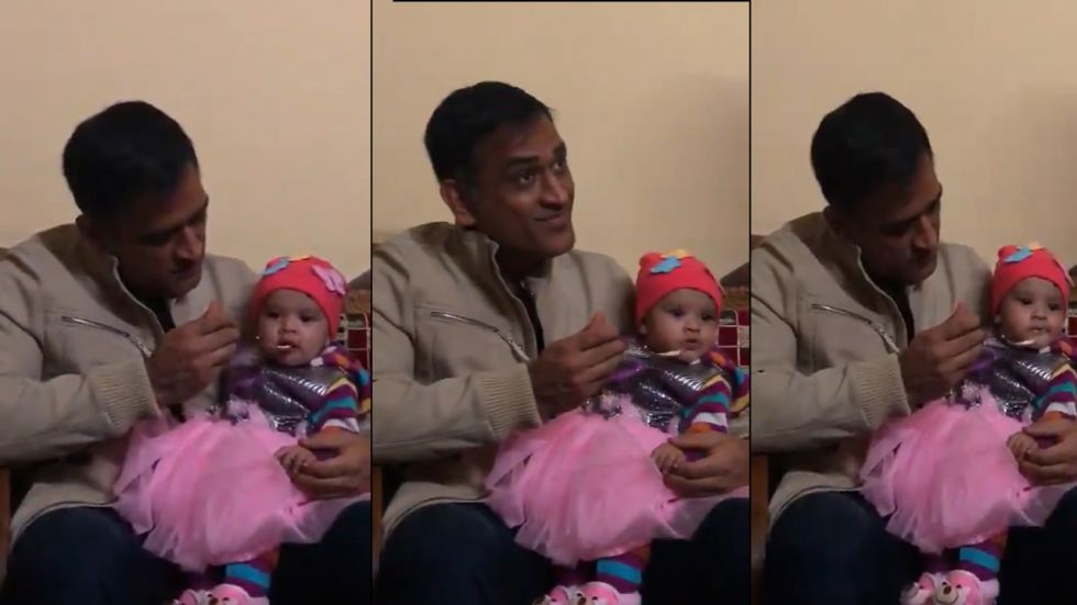 Former Indian Captain MS Dhoni feeding baby girl