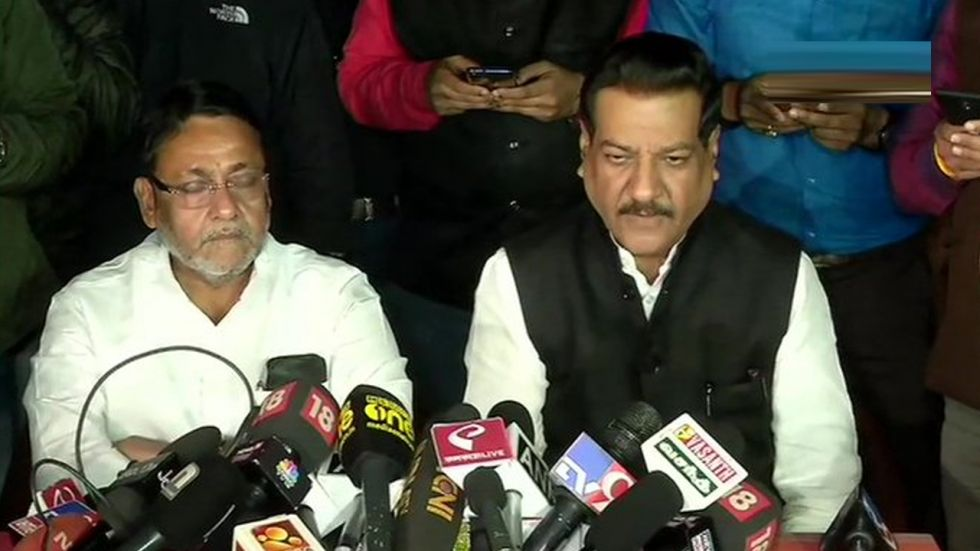 Congress leader Prithviraj Chavan with NCP's Nawab Malik during a joint press conference.