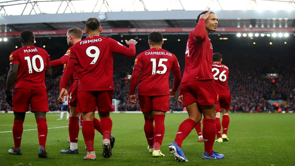Liverpool have gone 11 points clear at the top of the Premier League after beating Brighton 2-1.