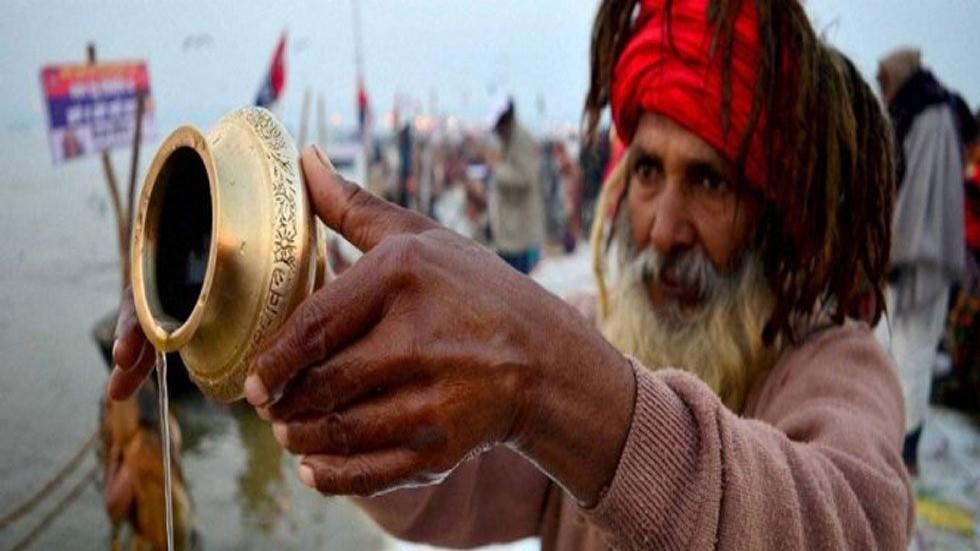 Man offering water to Sun god on Makar Sankranti