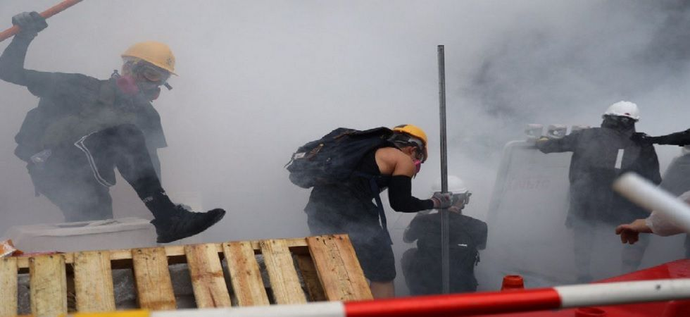 Hong Kong police fires water cannon at protesters for first time during clashes. (source: HKFP photo)