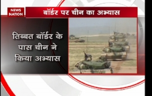 Chinese Army tests battle tank in Tibet near Indian border