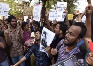 DU students stage protest against sexual harassment under the garb of Holi celebrations