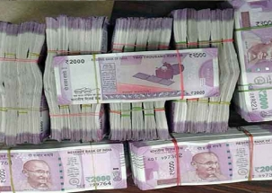 Half-burnt cash seized from gutted truck in south Kashmir