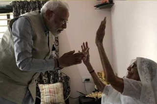 PM Narendra Modi meets his mother Heeraben before casting his vote