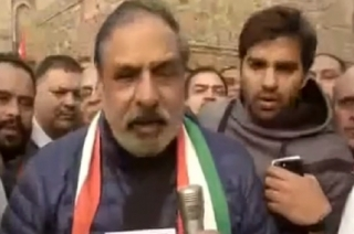 Congress leader Anand Sharma celebrates victory in Delhi