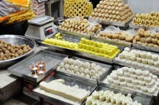 Confectionary serving sweets with party symbols in Howrah
