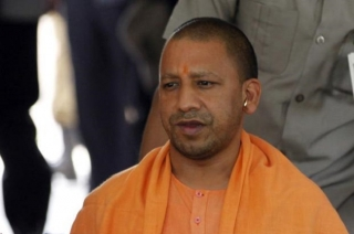 Yogi Adityanath meets family of martyred CRPF Constable in Maharajganj