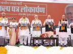 In pictures: BJP promises Ram Temple, Uniform Civil Code in its election manifesto